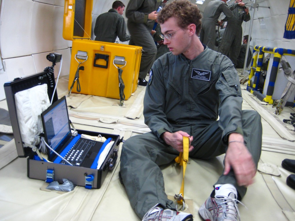 Getting the laptop set up to control the experiment and getting situated with a legstrap.